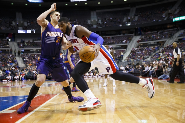 Jan 11, 2014; Auburn Hills, MI, USA; Detroit Pistons center Andre Drummond (0) moves the ball on Phoenix Suns center Alex Len (21) in the third quarter at The Palace of Auburn Hills. Detroit won 110-108. Mandatory Credit: Rick Osentoski-USA TODAY Sports