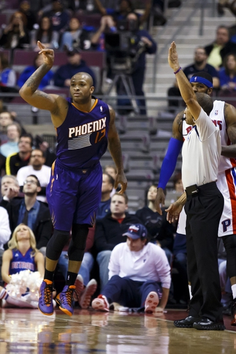 Jan 11, 2014; Auburn Hills, MI, USA; Phoenix Suns small forward P.J. Tucker (17) reacts after making a three point shot in the fourth quarter against the Detroit Pistons at The Palace of Auburn Hills. Detroit won 110-108. Mandatory Credit: Rick Osentoski-USA TODAY Sports