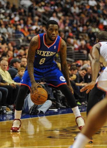 Jan 11, 2014; Philadelphia, PA, USA; Philadelphia 76ers shooting guard Tony Wroten (8) moves the ball upcourt during the game against the New York Knicks at the Wells Fargo Center. The New York Knicks won 102-92.Mandatory Credit: John Geliebter-USA TODAY Sports