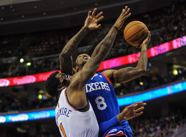 Jan 11, 2014; Philadelphia, PA, USA; Philadelphia 76ers shooting guard Tony Wroten (8) takes a shot as New York Knicks power forward Amar'e Stoudemire (1) defends during the game at the Wells Fargo Center. The New York Knicks won 102-92.Mandatory Credit: John Geliebter-USA TODAY Sports