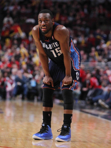 Jan 11, 2014; Chicago, IL, USA; Charlotte Bobcats point guard Kemba Walker (15) during the second half against the Chicago Bulls at the United Center. Chicago won 103-97. Mandatory Credit: Dennis Wierzbicki-USA TODAY Sports