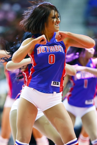 Jan 11, 2014; Auburn Hills, MI, USA; Detroit Pistons dancer performs during a time out against the Phoenix Suns at The Palace of Auburn Hills. Mandatory Credit: Rick Osentoski-USA TODAY Sports