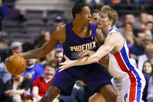 Jan 11, 2014; Auburn Hills, MI, USA; Phoenix Suns power forward Channing Frye (8) is defended by Detroit Pistons small forward Kyle Singler (25) in the first half at The Palace of Auburn Hills. Mandatory Credit: Rick Osentoski-USA TODAY Sports