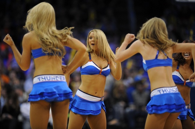 Jan 11, 2014; Oklahoma City, OK, USA; Members of the Oklahoma City Thunder dance team entertain during a break in action against the Milwaukee Bucks at Chesapeake Energy Arena. Mandatory Credit: Mark D. Smith-USA TODAY Sports