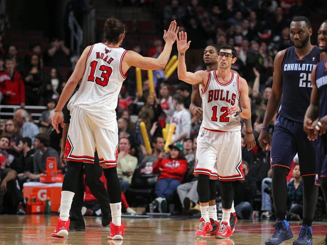 Jan 11, 2014; Chicago, IL, USA; Chicago Bulls center Joakim Noah (13) and shooting guard Kirk Hinrich (12) celebrate during the second half against the Charlotte Bobcats at the United Center. Chicago won 103-97. Mandatory Credit: Dennis Wierzbicki-USA TODAY Sports