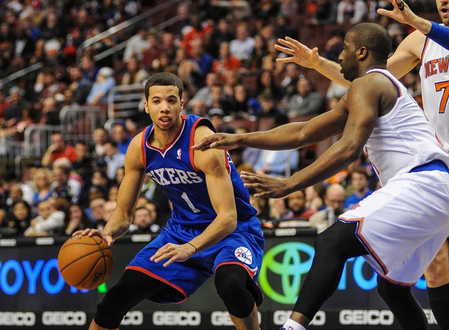 Jan 11, 2014; Philadelphia, PA, USA; Philadelphia 76ers point guard Michael Carter-Williams (1) moves the ball upcourt during the game against the New York Knicks at the Wells Fargo Center. The New York Knicks won 102-92.Mandatory Credit: John Geliebter-USA TODAY Sports