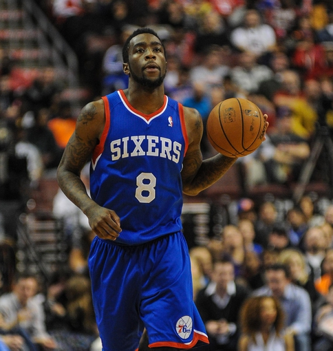 Jan 11, 2014; Philadelphia, PA, USA; Philadelphia 76ers shooting guard Tony Wroten (8) moves the ball up court during the game against the New York Knicks at the Wells Fargo Center. The New York Knicks won 102-92.Mandatory Credit: John Geliebter-USA TODAY Sports