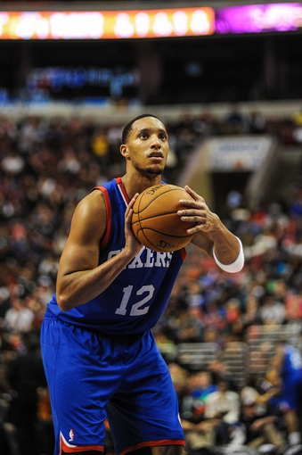 Jan 11, 2014; Philadelphia, PA, USA; Philadelphia 76ers small forward Evan Turner (12) takes a foul shot during the game against the New York Knicks at the Wells Fargo Center. The New York Knicks won 102-92.Mandatory Credit: John Geliebter-USA TODAY Sports