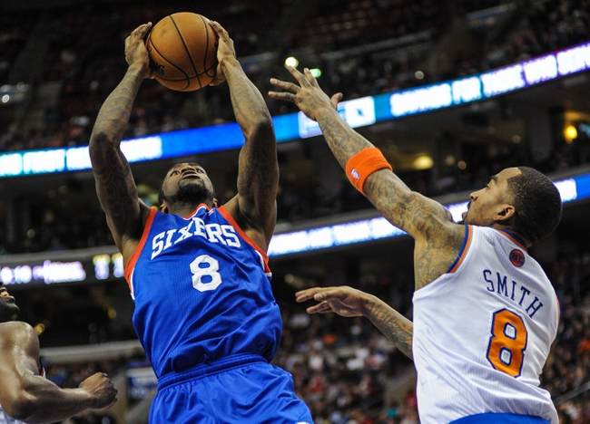 Jan 11, 2014; Philadelphia, PA, USA; Philadelphia 76ers shooting guard Tony Wroten (8) takes a shot as New York Knicks shooting guard J.R. Smith (8) defends during the game at the Wells Fargo Center. The New York Knicks won 102-92.Mandatory Credit: John Geliebter-USA TODAY Sports