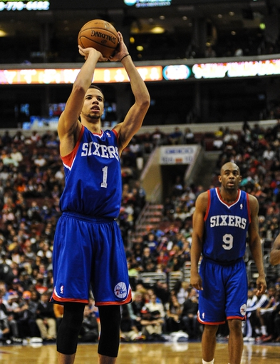 Jan 11, 2014; Philadelphia, PA, USA; Philadelphia 76ers point guard Michael Carter-Williams (1) shoots from the foul line during the game against the New York Knicks at the Wells Fargo Center. The New York Knicks won 102-92.Mandatory Credit: John Geliebter-USA TODAY Sports