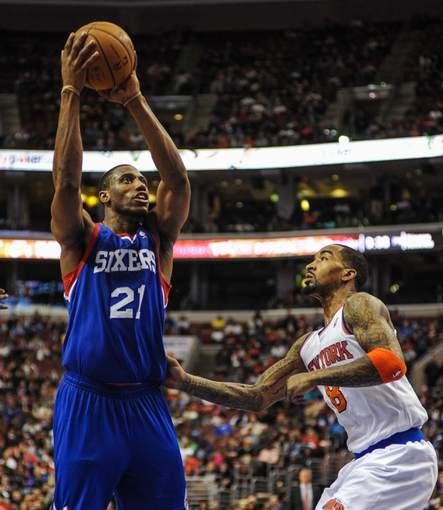 Jan 11, 2014; Philadelphia, PA, USA; Philadelphia 76ers power forward Thaddeus Young (21) takes a shot as New York Knicks shooting guard J.R. Smith (8) defends during the game at the Wells Fargo Center. The New York Knicks won 102-92.Mandatory Credit: John Geliebter-USA TODAY Sports