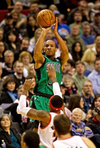 Jan 11, 2014; Portland, OR, USA; Boston Celtics point guard Avery Bradley (0) shoots over Portland Trail Blazers point guard Mo Williams (25) at the Moda Center. Mandatory Credit: Craig Mitchelldyer-USA TODAY Sports