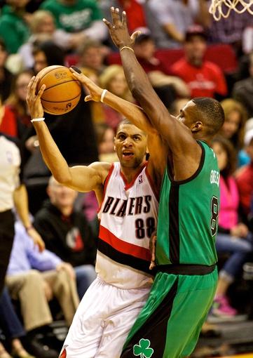Jan 11, 2014; Portland, OR, USA; Portland Trail Blazers small forward Nicolas Batum (88) shoots over Boston Celtics small forward Jeff Green (8) at the Moda Center. Mandatory Credit: Craig Mitchelldyer-USA TODAY Sports