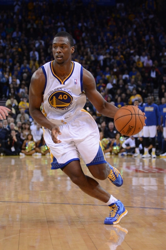 November 20, 2013; Oakland, CA, USA; Golden State Warriors small forward Harrison Barnes (40) dribbles the basketball during the fourth quarter against the Memphis Grizzlies at Oracle Arena. The Grizzlies defeated the Warriors 88-81 in overtime. Mandatory Credit: Kyle Terada-USA TODAY Sports