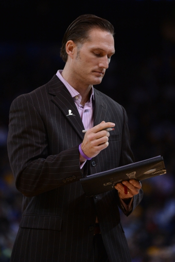 November 20, 2013; Oakland, CA, USA; Memphis Grizzlies head athletic trainer Drew Graham during the fourth quarter against the Golden State Warriors at Oracle Arena. The Grizzlies defeated the Warriors 88-81 in overtime. Mandatory Credit: Kyle Terada-USA TODAY Sports