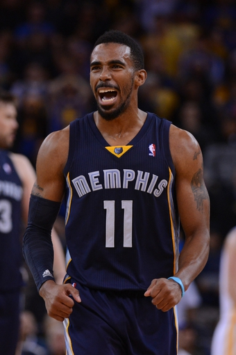 November 20, 2013; Oakland, CA, USA; Memphis Grizzlies point guard Mike Conley (11) celebrates during overtime against the Golden State Warriors at Oracle Arena. The Grizzlies defeated the Warriors 88-81 in overtime. Mandatory Credit: Kyle Terada-USA TODAY Sports