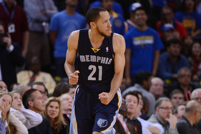 November 20, 2013; Oakland, CA, USA; Memphis Grizzlies small forward Tayshaun Prince (21) celebrates after making a three-point basket during overtime against the Golden State Warriors at Oracle Arena. The Grizzlies defeated the Warriors 88-81 in overtime. Mandatory Credit: Kyle Terada-USA TODAY Sports