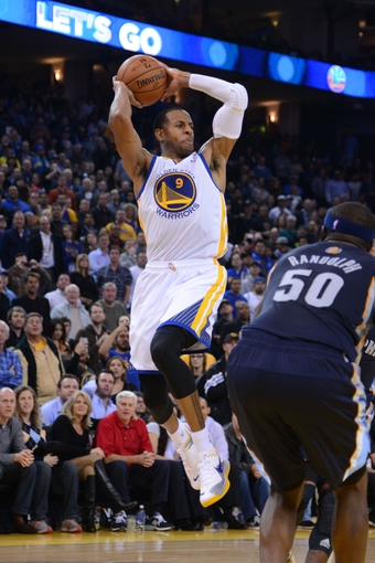 November 20, 2013; Oakland, CA, USA; Golden State Warriors small forward Andre Iguodala (9) passes the basketball during the fourth quarter against the Memphis Grizzlies at Oracle Arena. The Grizzlies defeated the Warriors 88-81 in overtime. Mandatory Credit: Kyle Terada-USA TODAY Sports