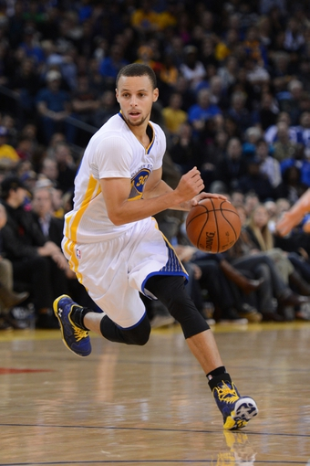 November 23, 2013; Oakland, CA, USA; Golden State Warriors point guard Stephen Curry (30) dribbles the basketball during the fourth quarter against the Portland Trail Blazers at Oracle Arena. The Trail Blazers defeated the Warriors 113-101. Mandatory Credit: Kyle Terada-USA TODAY Sports
