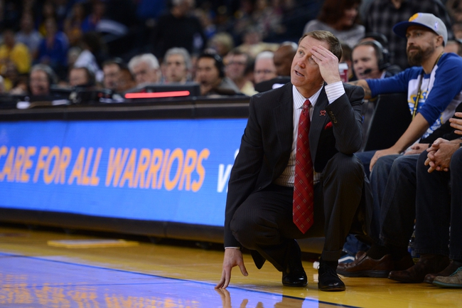 November 23, 2013; Oakland, CA, USA; Portland Trail Blazers head coach Terry Stotts reacts on the sideline during the fourth quarter against the Golden State Warriors at Oracle Arena. The Trail Blazers defeated the Warriors 113-101. Mandatory Credit: Kyle Terada-USA TODAY Sports