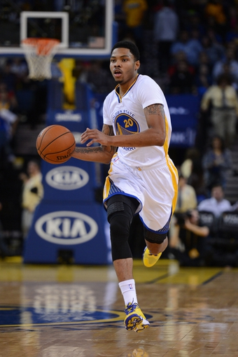 November 23, 2013; Oakland, CA, USA; Golden State Warriors shooting guard Kent Bazemore (20) dribbles the basketball during the fourth quarter against the Portland Trail Blazers at Oracle Arena. The Trail Blazers defeated the Warriors 113-101. Mandatory Credit: Kyle Terada-USA TODAY Sports