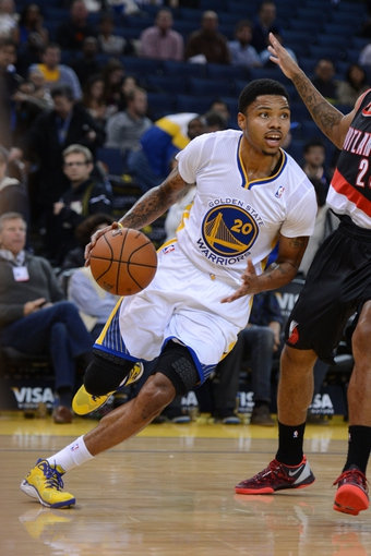 November 23, 2013; Oakland, CA, USA; Golden State Warriors shooting guard Kent Bazemore (20) dribbles the basketball against Portland Trail Blazers shooting guard Allen Crabbe (23) during the fourth quarter at Oracle Arena. The Trail Blazers defeated the Warriors 113-101. Mandatory Credit: Kyle Terada-USA TODAY Sports