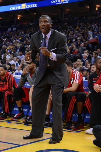 December 3, 2013; Oakland, CA, USA; Toronto Raptors head coach Dwane Casey reacts during the fourth quarter against the Golden State Warriors at Oracle Arena. The Warriors defeated the Raptors 112-103. Mandatory Credit: Kyle Terada-USA TODAY Sports