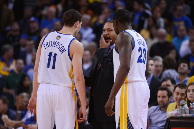 December 3, 2013; Oakland, CA, USA; Golden State Warriors head coach Mark Jackson (center) instructs shooting guard Klay Thompson (11) and small forward Draymond Green (23) during the fourth quarter against the Toronto Raptors at Oracle Arena. The Warriors defeated the Raptors 112-103. Mandatory Credit: Kyle Terada-USA TODAY Sports
