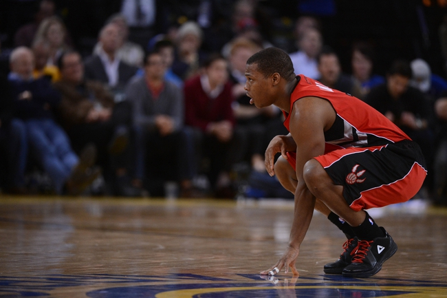 December 3, 2013; Oakland, CA, USA; Toronto Raptors point guard Kyle Lowry (7) looks on during the fourth quarter against the Golden State Warriors at Oracle Arena. The Warriors defeated the Raptors 112-103. Mandatory Credit: Kyle Terada-USA TODAY Sports
