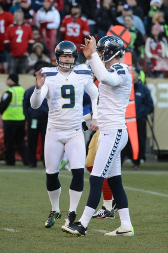 December 8, 2013; San Francisco, CA, USA; Seattle Seahawks punter Jon Ryan (9) celebrates with kicker Steven Hauschka (4) after a made field goal during the fourth quarter against the San Francisco 49ers at Candlestick Park. The 49ers defeated the Seahawks 19-17. Mandatory Credit: Kyle Terada-USA TODAY Sports