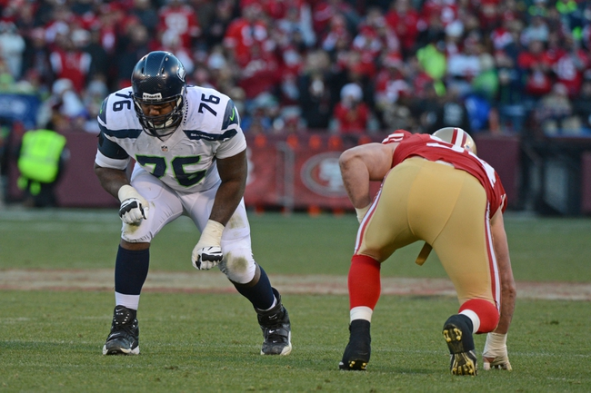 December 8, 2013; San Francisco, CA, USA; Seattle Seahawks tackle Russell Okung (76) lines up during the fourth quarter against the San Francisco 49ers at Candlestick Park. The 49ers defeated the Seahawks 19-17. Mandatory Credit: Kyle Terada-USA TODAY Sports