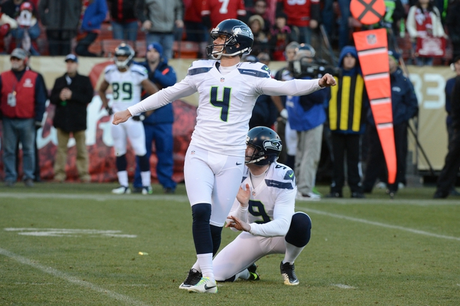 December 8, 2013; San Francisco, CA, USA; Seattle Seahawks kicker Steven Hauschka (4) kicks a field goal out of the hold by punter Jon Ryan (9) during the fourth quarter against the San Francisco 49ers at Candlestick Park. The 49ers defeated the Seahawks 19-17. Mandatory Credit: Kyle Terada-USA TODAY Sports