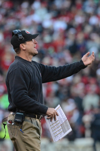 December 8, 2013; San Francisco, CA, USA; San Francisco 49ers head coach Jim Harbaugh instructs during the fourth quarter against the Seattle Seahawks at Candlestick Park. The 49ers defeated the Seahawks 19-17. Mandatory Credit: Kyle Terada-USA TODAY Sports
