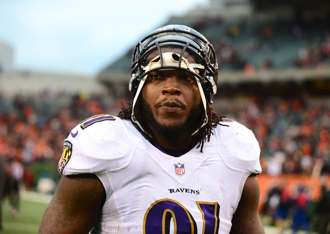 Dec 29, 2013; Cincinnati, OH, USA; Baltimore Ravens outside linebacker Courtney Upshaw (91) against the Cincinnati Bengals at Paul Brown Stadium. Bengals defeated the Ravens 34-17. Mandatory Credit: Andrew Weber-USA TODAY Sports