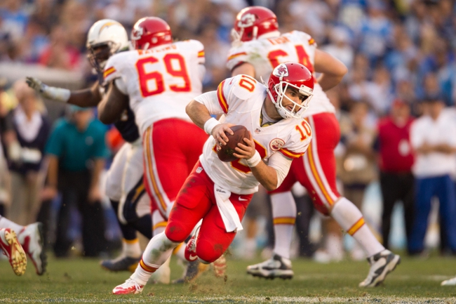 Dec 29, 2013; San Diego, CA, USA;  Kansas City Chiefs quarterback Chase Daniel (10) rolls out of the pocket during the Chiefs 27-24 overtime loss to the San Diego Chargers at Qualcomm Stadium. Mandatory Credit: Stan Liu-USA TODAY Sports