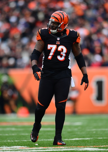 Dec 29, 2013; Cincinnati, OH, USA; Cincinnati Bengals tackle Anthony Collins (73) against the Baltimore Ravens at Paul Brown Stadium. Bengals defeated the Ravens 34-17. Mandatory Credit: Andrew Weber-USA TODAY Sports