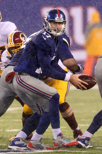 Dec 29, 2013; East Rutherford, NJ, USA; New York Giants quarterback Curtis Painter (17) takes a snap against the Washington Redskins during a game at MetLife Stadium. The Giants defeated the Redskins 20-6. Mandatory Credit: Brad Penner-USA TODAY Sports