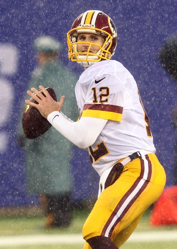 Dec 29, 2013; East Rutherford, NJ, USA; Washington Redskins quarterback Kirk Cousins (12) looks to pass against the New York Giants during a game at MetLife Stadium. The Giants defeated the Redskins 20-6. Mandatory Credit: Brad Penner-USA TODAY Sports