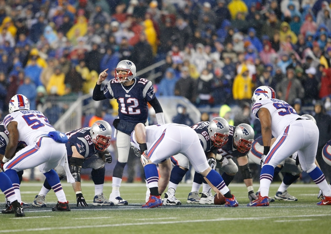 Dec 29, 2013; Foxborough, MA, USA; New England Patriots quarterback Tom Brady (12) on the line of scrimmage against the Buffalo Bills during the first half at Gillette Stadium. The Patriots defeated the Bills 34-20. Mandatory Credit: David Butler II-USA TODAY Sports