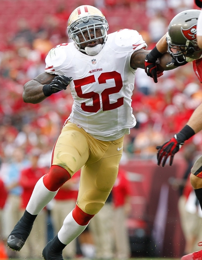 Dec 15, 2013; Tampa, FL, USA; San Francisco 49ers inside linebacker Patrick Willis (52) rushes against the Tampa Bay Buccaneers during the second half at Raymond James Stadium. San Francisco 49ers defeated the Tampa Bay Buccaneers 33-14. Mandatory Credit: Kim Klement-USA TODAY Sports