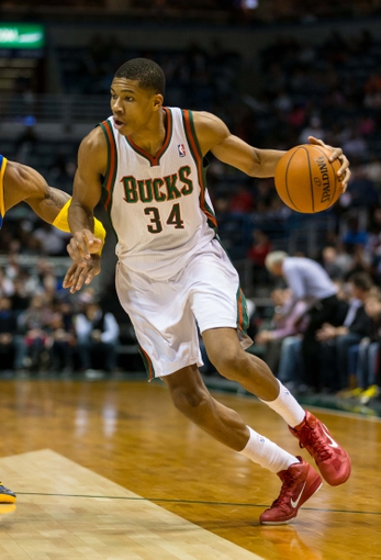 Jan 7, 2014; Milwaukee, WI, USA; Milwaukee Bucks guard Giannis Antetokounmpo (34) during the game against the Golden State Warriors at BMO Harris Bradley Center.  Golden State won 101-80.  Mandatory Credit: Jeff Hanisch-USA TODAY Sports