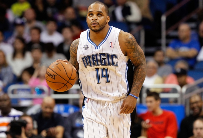 Dec 13, 2013; Orlando, FL, USA; Orlando Magic point guard Jameer Nelson (14) drives to the basket against the Cleveland Cavaliers during the second half at Amway Center. Cleveland Cavaliers defeated the Orlando Magic 109-100. Mandatory Credit: Kim Klement-USA TODAY Sports