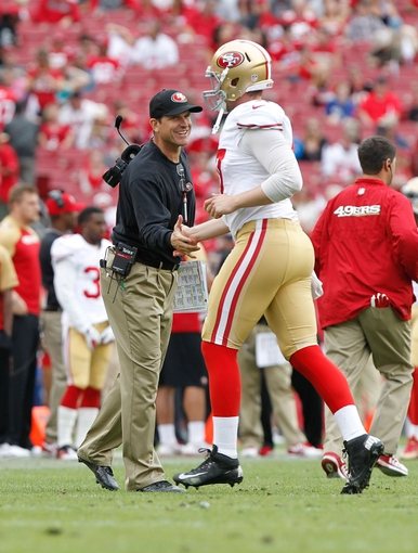 Dec 15, 2013; Tampa, FL, USA; San Francisco 49ers head coach Jim Harbaugh high fives long snapper Kevin McDermott (47) during the second half at Raymond James Stadium. San Francisco 49ers defeated the Tampa Bay Buccaneers 33-14. Mandatory Credit: Kim Klement-USA TODAY Sports