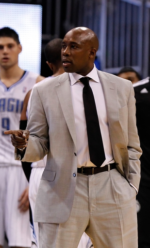 Dec 13, 2013; Orlando, FL, USA; Orlando Magic head coach Jacque Vaughn points against the Cleveland Cavaliers during the second half at Amway Center. Cleveland Cavaliers defeated the Orlando Magic 109-100. Mandatory Credit: Kim Klement-USA TODAY Sports