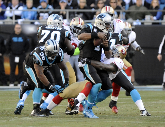 Jan 12, 2014; Charlotte, NC, USA; Carolina Panthers quarterback Cam Newton (1) is sacked by San Francisco 49ers inside linebacker NaVorro Bowman (53) during the third quarter of the 2013 NFC divisional playoff football game at Bank of America Stadium. Mandatory Credit: Sam Sharpe-USA TODAY Sports