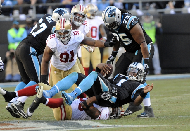 Jan 12, 2014; Charlotte, NC, USA; Carolina Panthers quarterback Cam Newton (1) is sacked by San Francisco 49ers outside linebacker Ahmad Brooks (55) during the third quarter of the 2013 NFC divisional playoff football game at Bank of America Stadium. Mandatory Credit: Sam Sharpe-USA TODAY Sports