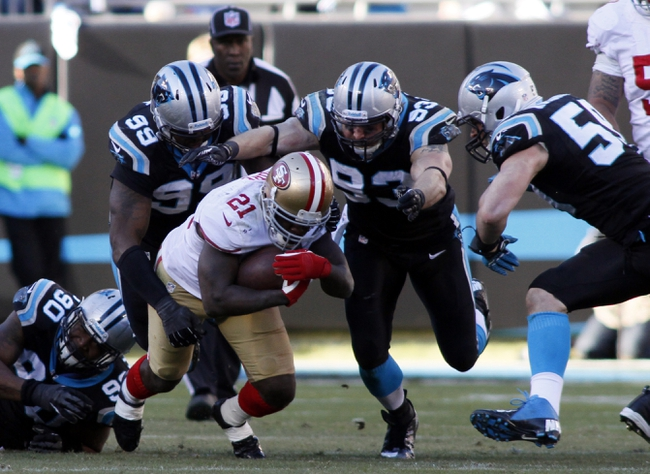Jan 12, 2014; Charlotte, NC, USA; San Francisco 49ers running back Frank Gore (21) is brought down by Carolina Panthers defensive tackle Kawann Short (99) and outside linebacker Chase Blackburn (93) during the second half of the 2013 NFC divisional playoff football game at Bank of America Stadium. Mandatory Credit: Jeremy Brevard-USA TODAY Sports
