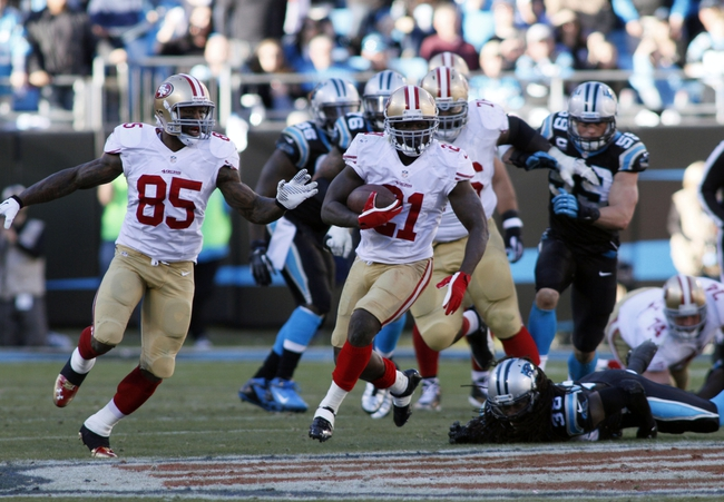 Jan 12, 2014; Charlotte, NC, USA; San Francisco 49ers running back Frank Gore (21) runs against the Carolina Panthers during the second half of the 2013 NFC divisional playoff football game at Bank of America Stadium. Mandatory Credit: Jeremy Brevard-USA TODAY Sports