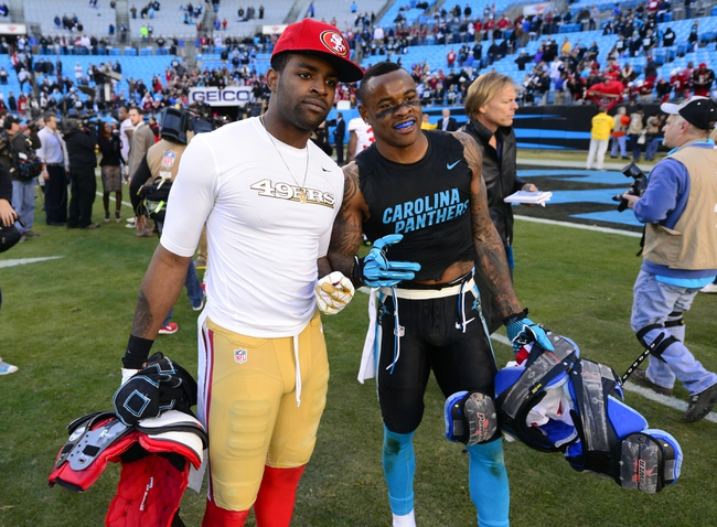 Jan 12, 2014; Charlotte, NC, USA; San Francisco 49ers wide receiver Michael Crabtree (15) and Carolina Panthers wide receiver Ted Ginn (19) after the 2013 NFC divisional playoff football game at Bank of America Stadium. San Francisco won 23-10. Mandatory Credit: Bob Donnan-USA TODAY Sports