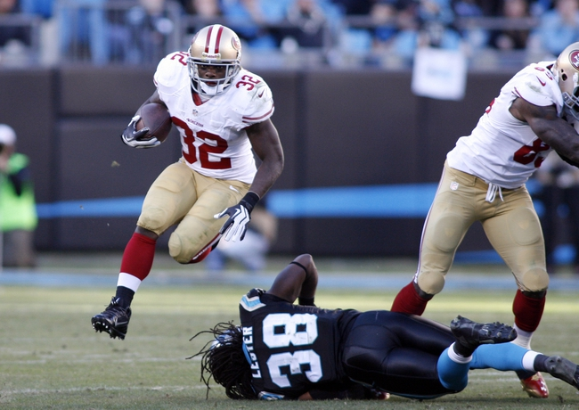 Jan 12, 2014; Charlotte, NC, USA; San Francisco 49ers running back Kendall Hunter (32) runs against Carolina Panthers strong safety Robert Lester (38) during the fourth quarter of the 2013 NFC divisional playoff football game at Bank of America Stadium. San Francisco won 23-10. Mandatory Credit: Jeremy Brevard-USA TODAY Sports